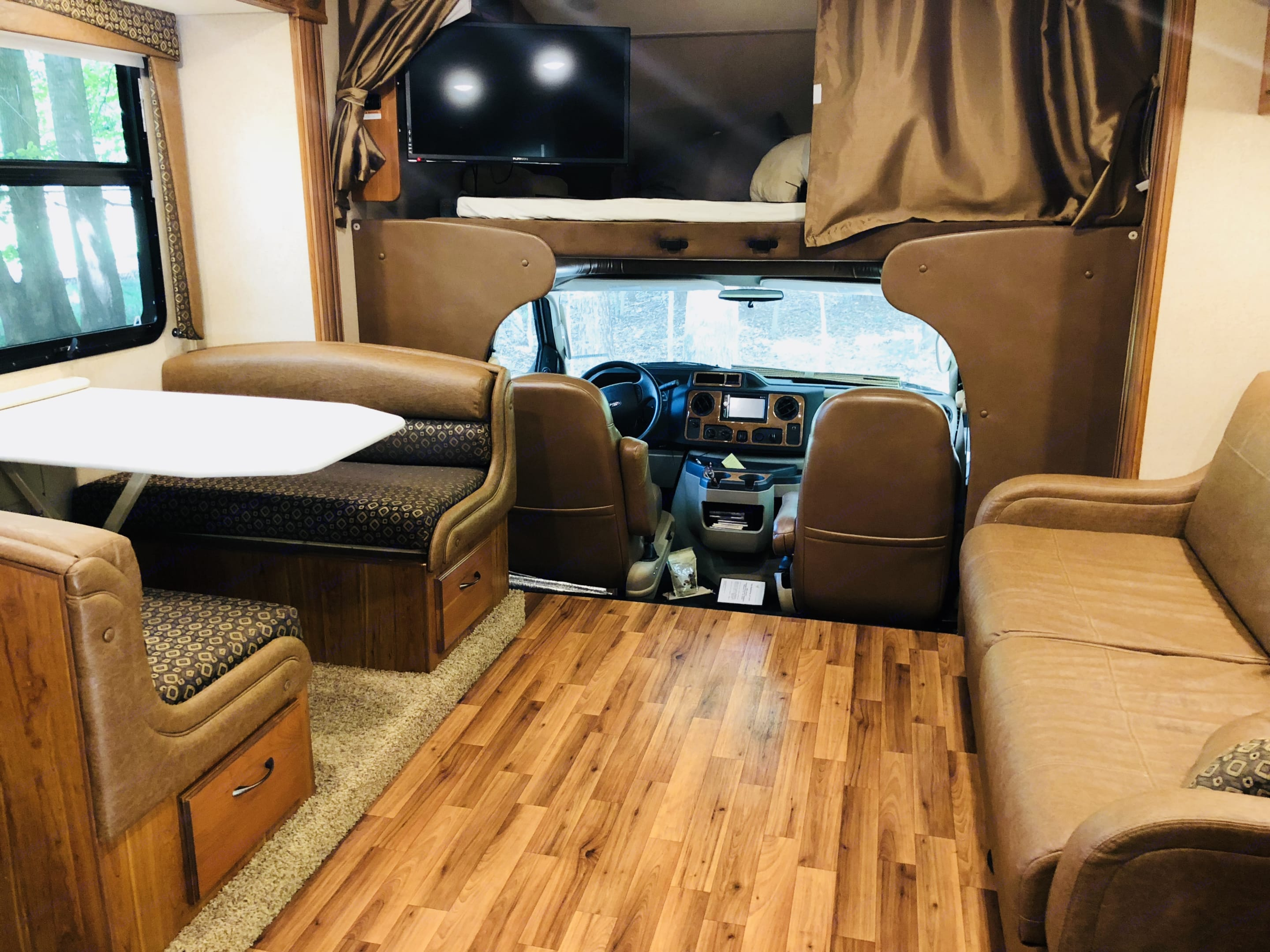 Sofa and table set up.  DVD screen rotated out for viewing.. Jayco grey hawk 2016