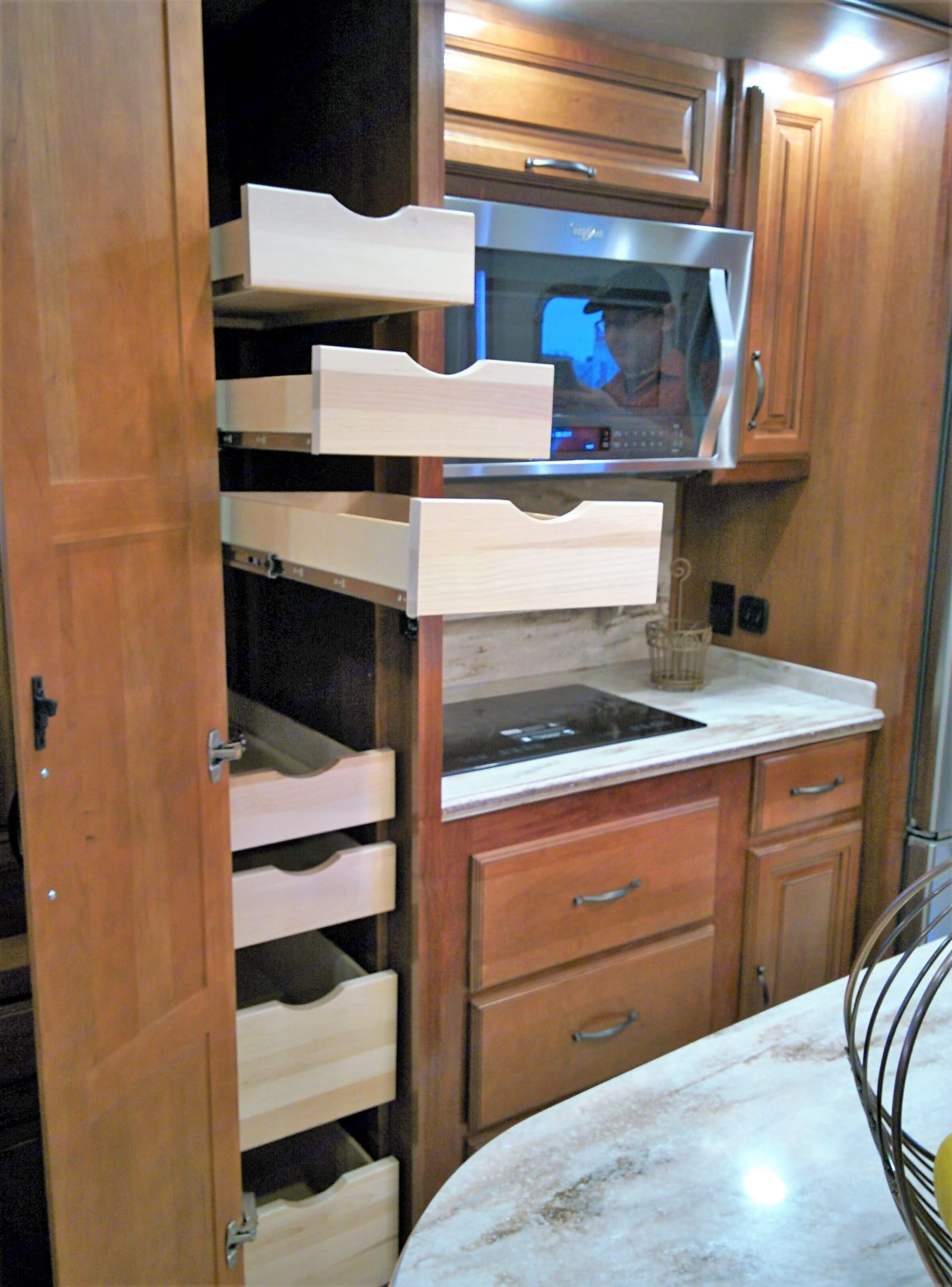 In the kitchen you'll find a super quiet drawer dishwasher, a two burner induction cooktop, a convention microwave/oven and a double sink.. Redwood 39WB 2016
