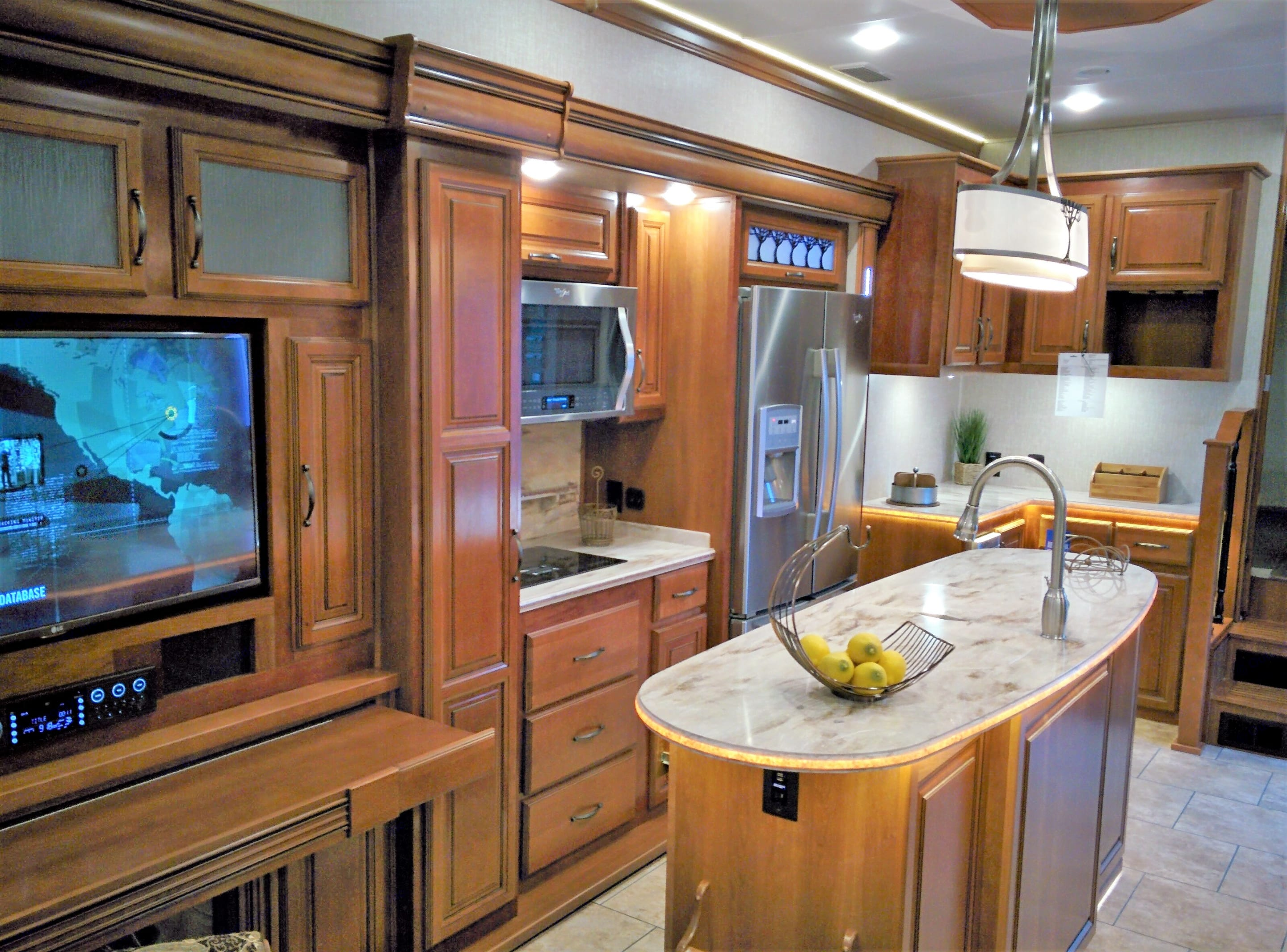 Under the TV and sound system, you'll find a slide-out desk and a fireplace.. Redwood 39WB 2016
