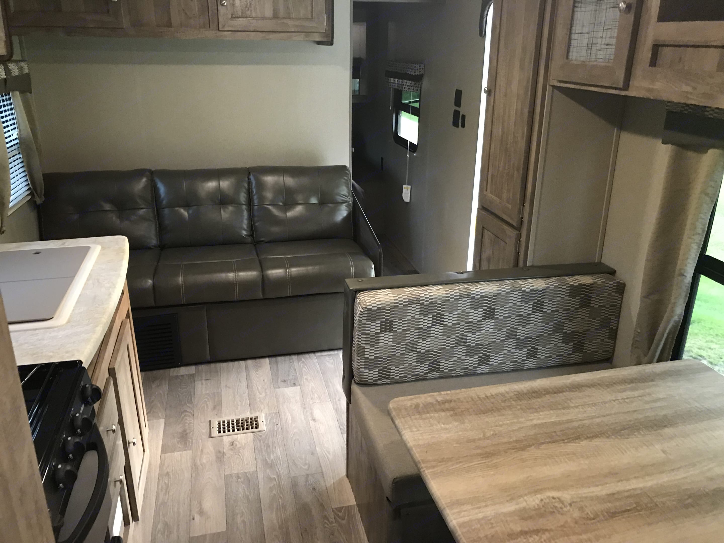 Couch opens up to a double bed or seat and relax in aircoditioning.. Forest River Puma 2018