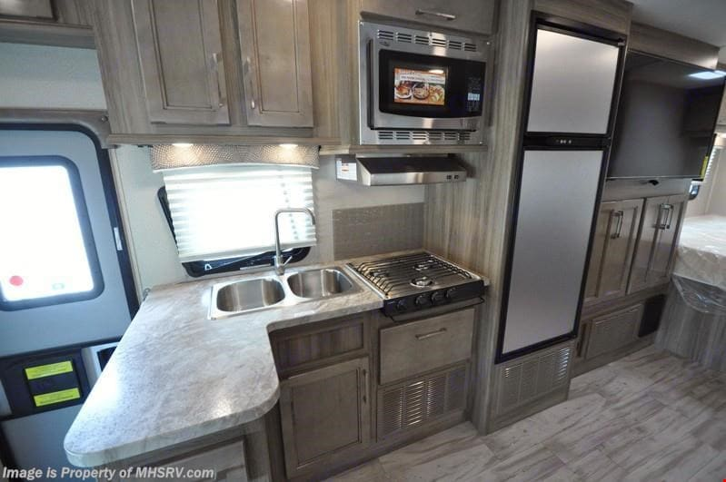 Equipped with a stove, convection microwave oven, fridge and sink. Entegra Coach Other 2019