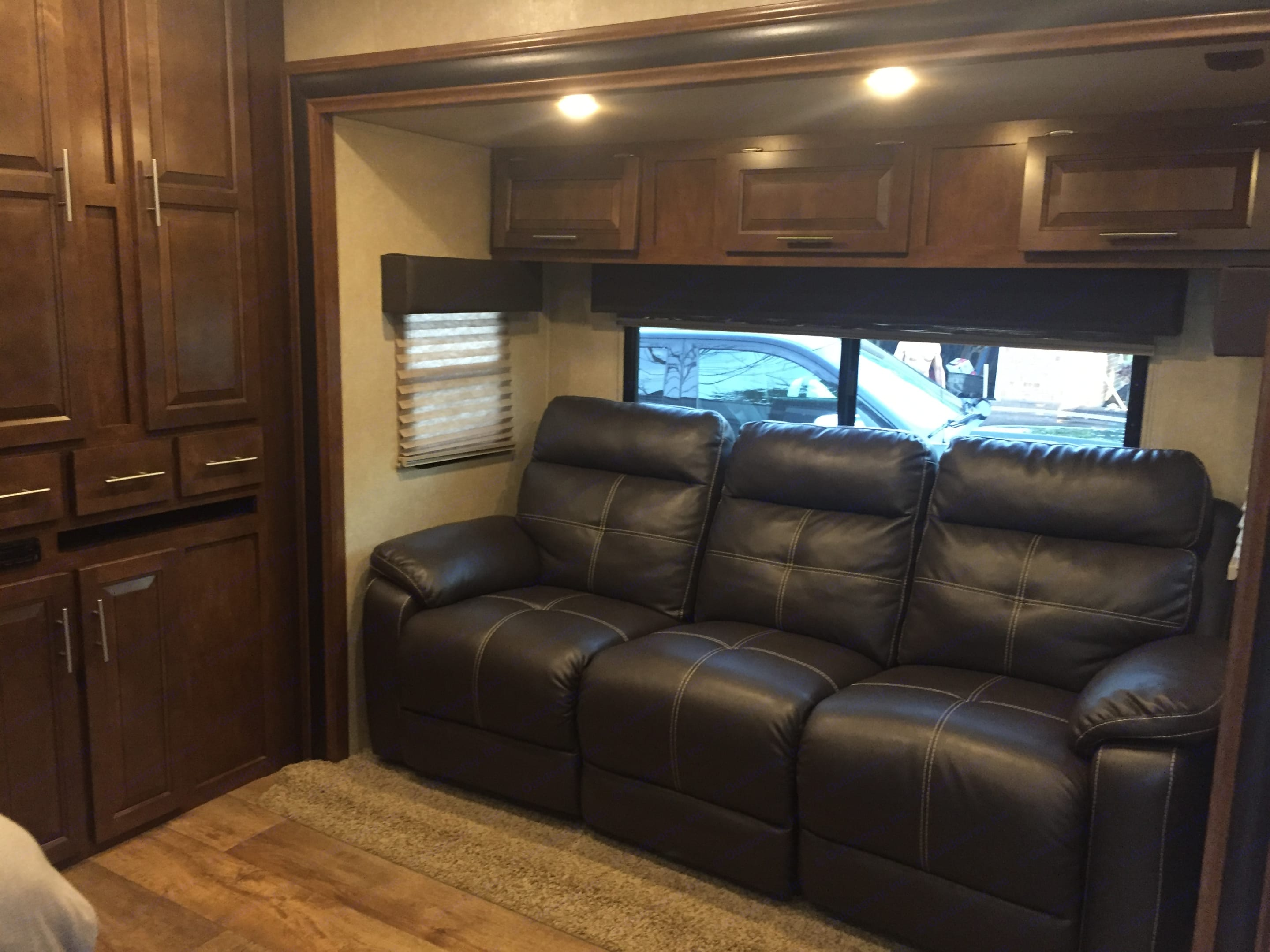 Slide out living room makes for a very spacious feel. All three sections of the sofa recline. Plenty of storage available. Folding dinner table included.. Forest River Lite 2015