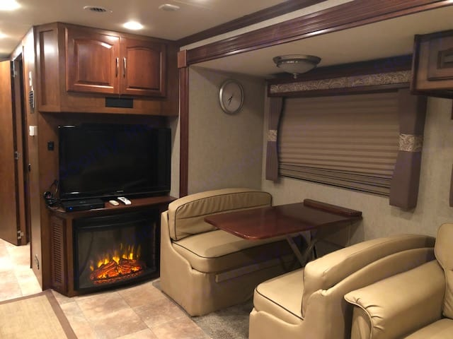dinette with living room TV and fireplace. Coachmen Encounter 2013