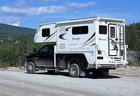 Bonanza Creek Road, Dawson City, Yukon. RAM 3500 SLT 4WD Diesel Dually Truck 2015 ALP Adventurer 910DB Single Slide Camper 2015