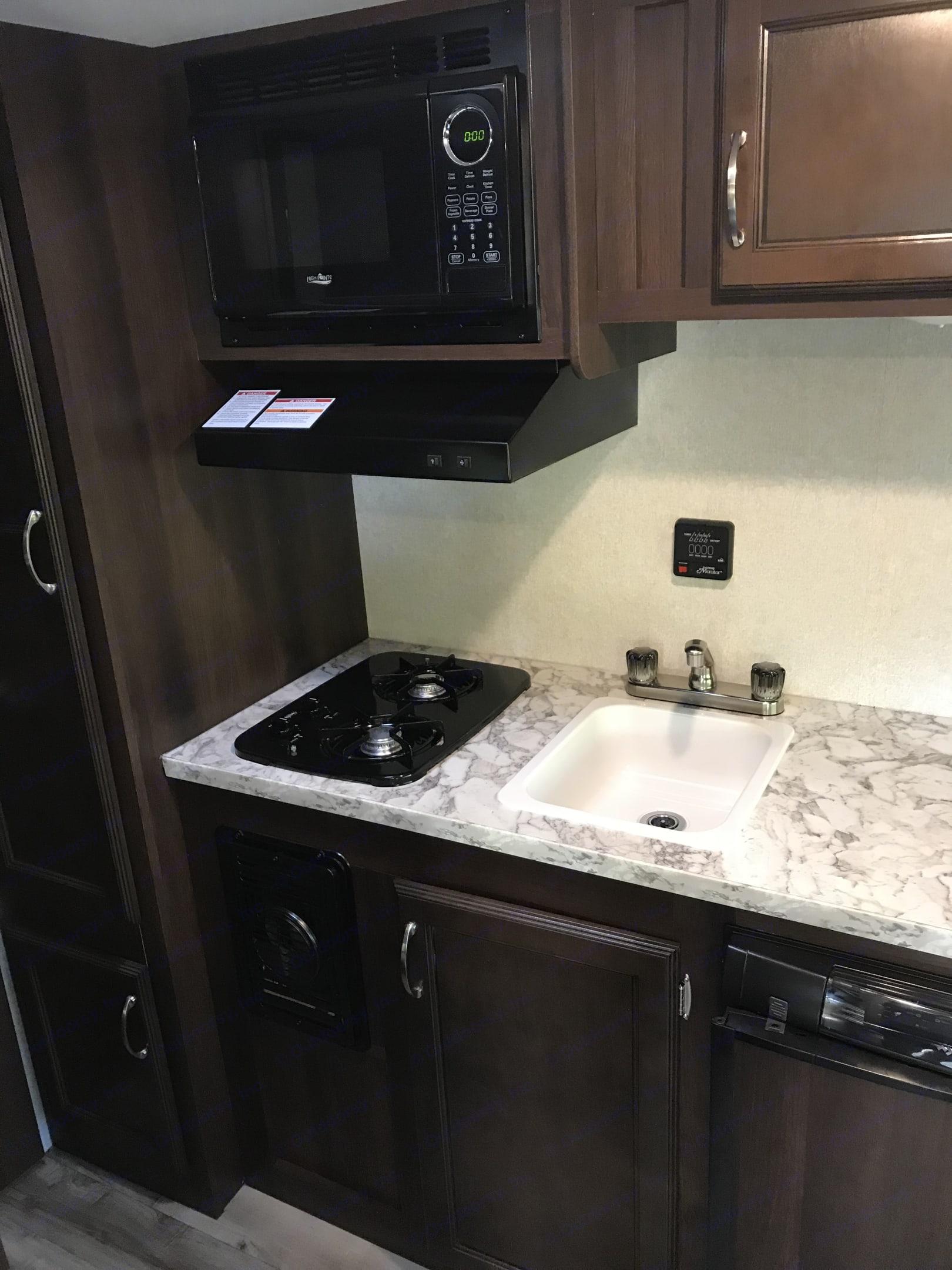 Kitchen counter / sink / 2 burner stove / range hood with exhaust . Jayco Jay Flight 2018