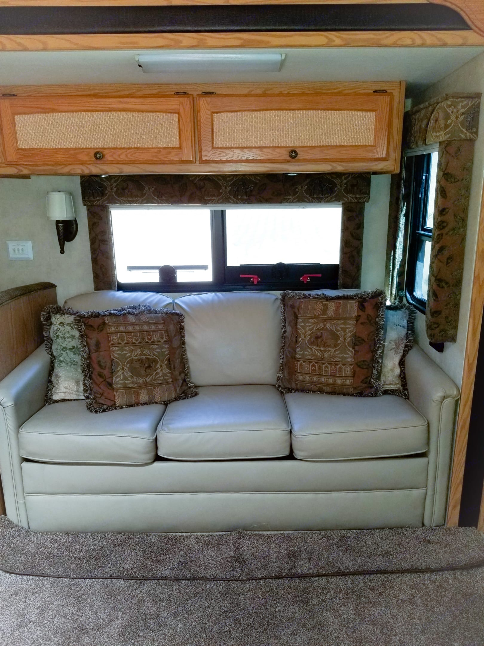 As you walk into the front door this is your direct view, Comfy leather couch is a pull our sleeper, Full size bed.. Monaco Simba 2012