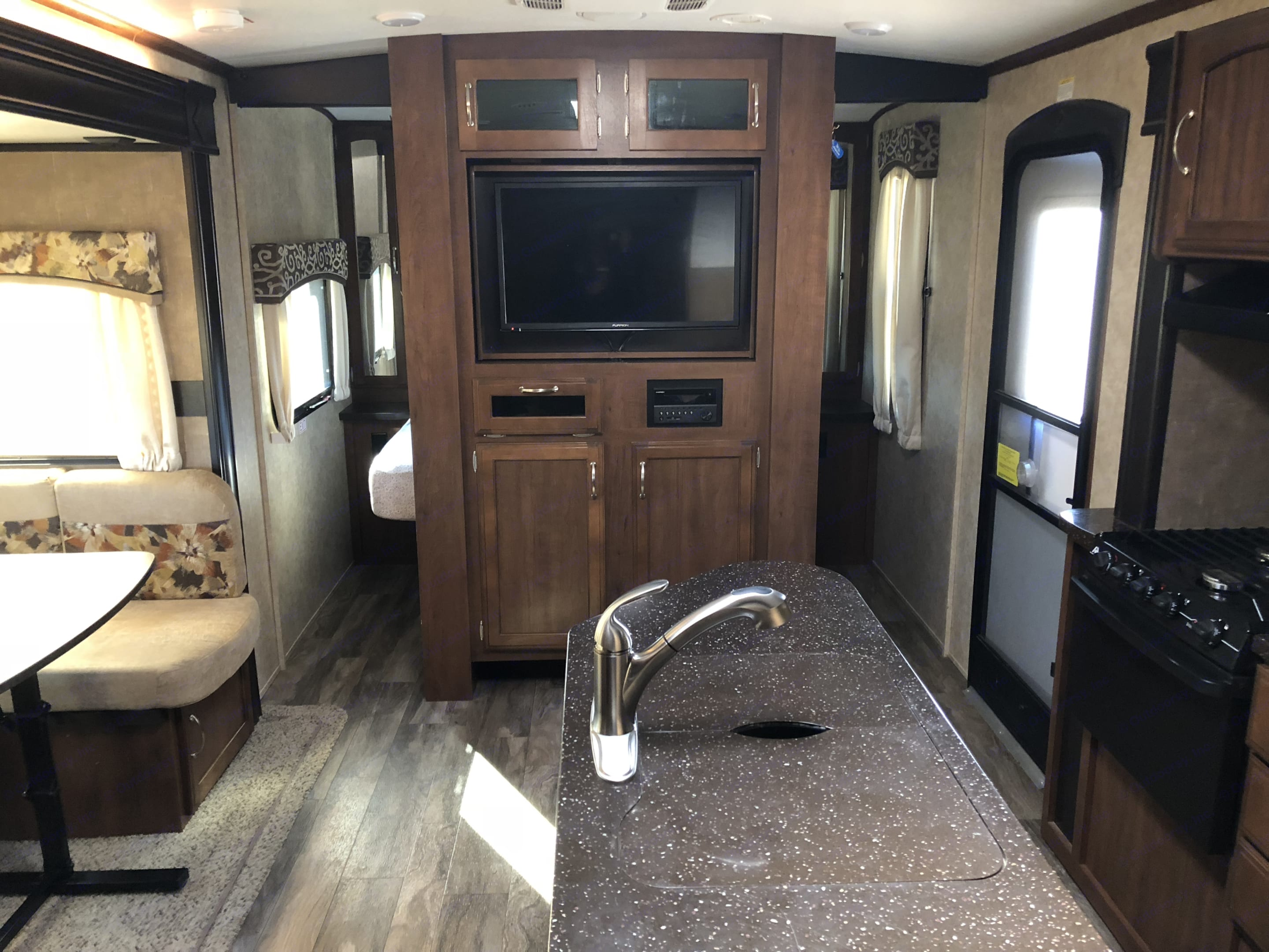 Bedroom has entrance on both sides with sliding doors for privacy.. Jayco White Hawk 2017
