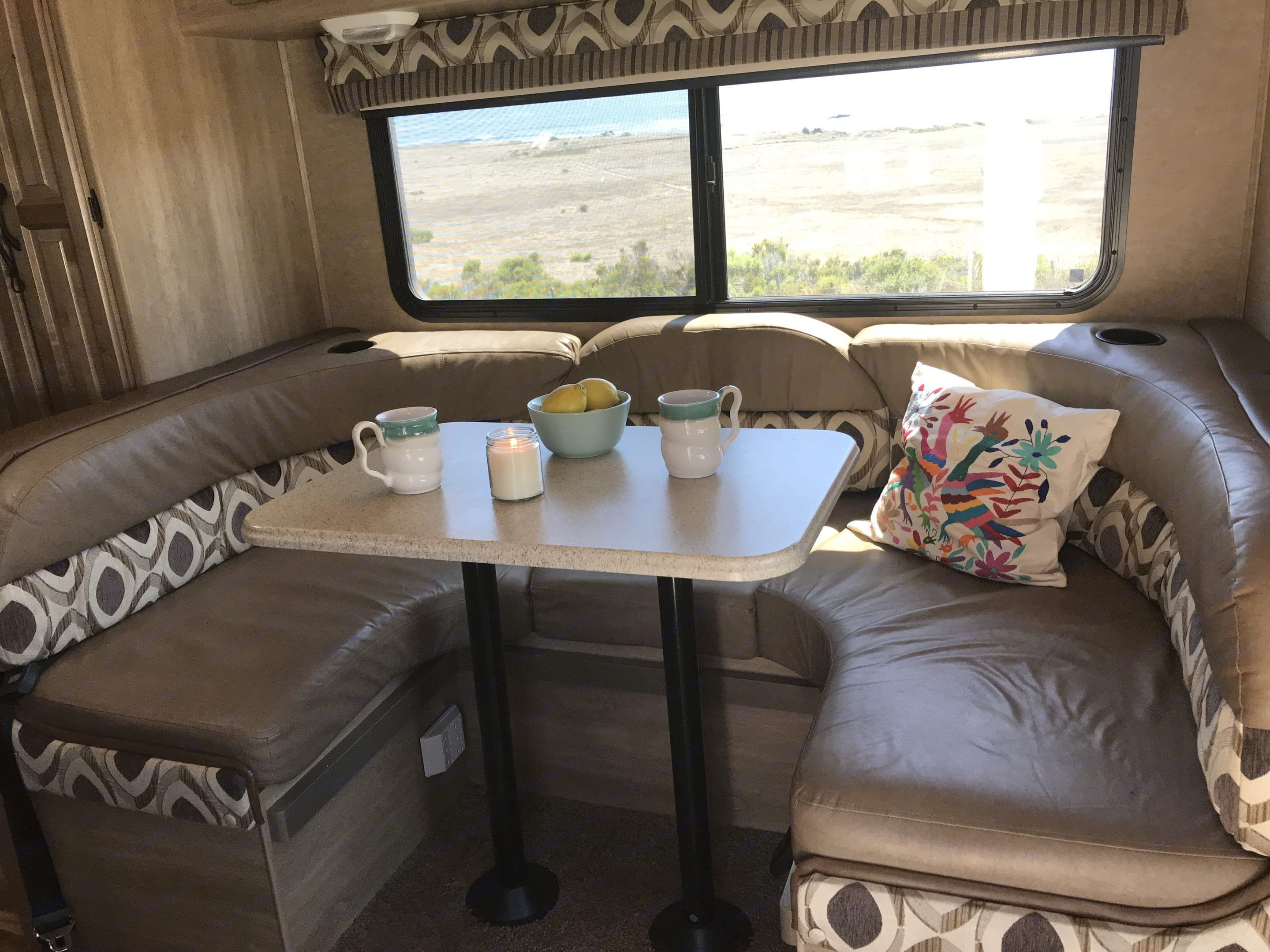 Horseshoe dining table with screened window. Coachmen Prism 2015