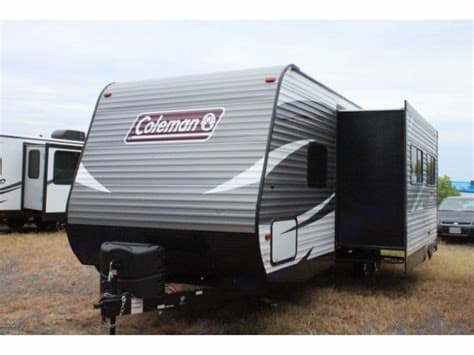 Front of camper and slide out located at booth . Coleman COLEMAN CM244BH18 2018