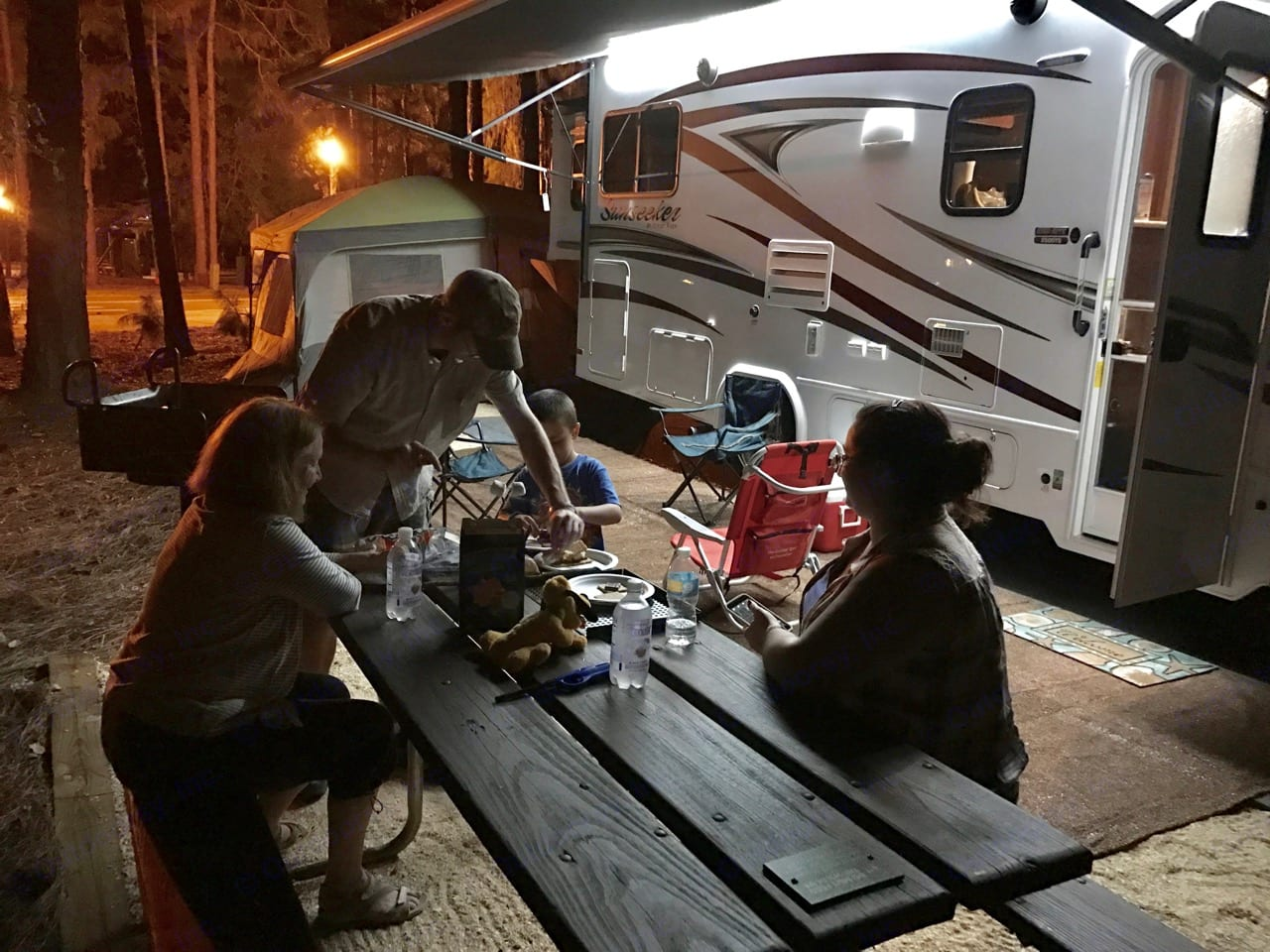 Outdoor awning lighted at Ft. Wilderness Disney FL. Forest River Sunseeker 2017