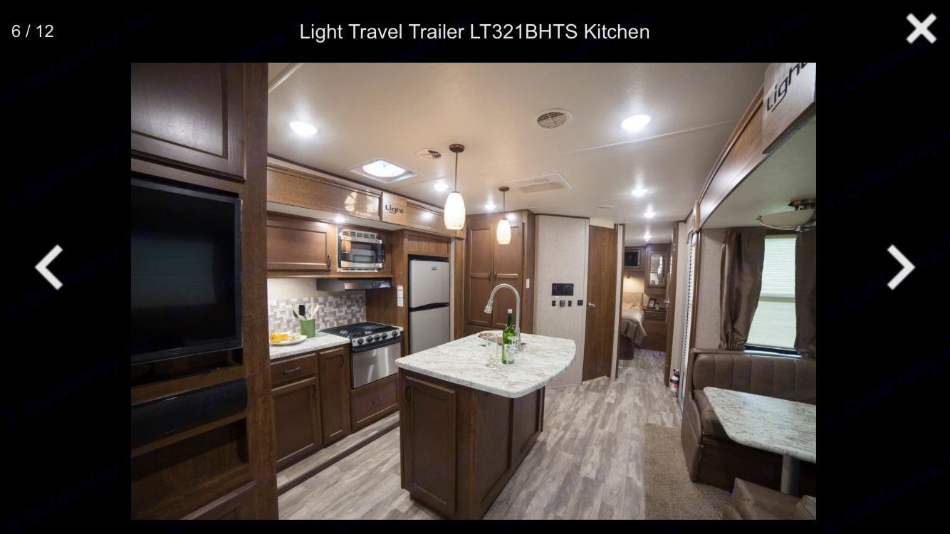 Spacious kitchen with two slide outs. Fridge, stove, oven, island, lots of storage, 2 recliners, and table that converts into bed. Television in main living space. . Open Range Light 2018