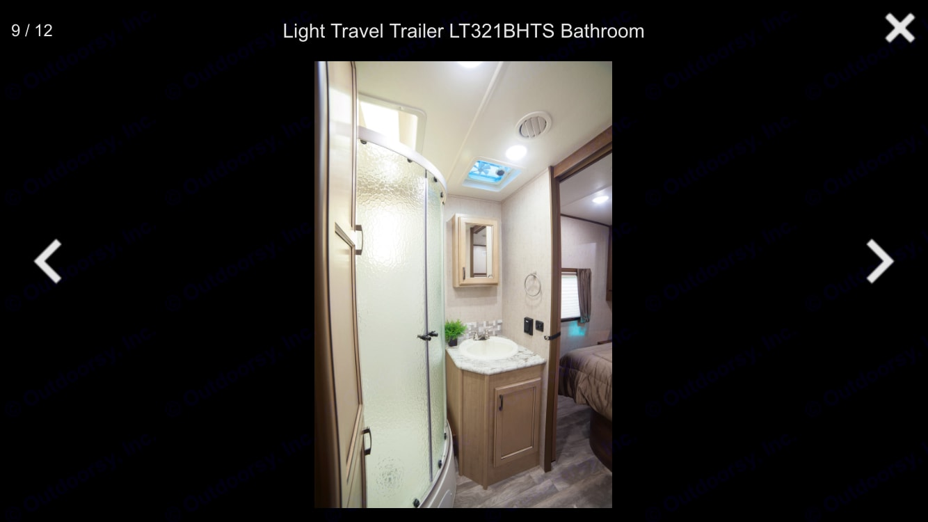 Cute bathroom has additional storage space and door right by main entrance and ito master bedroom. . Open Range Light 2018