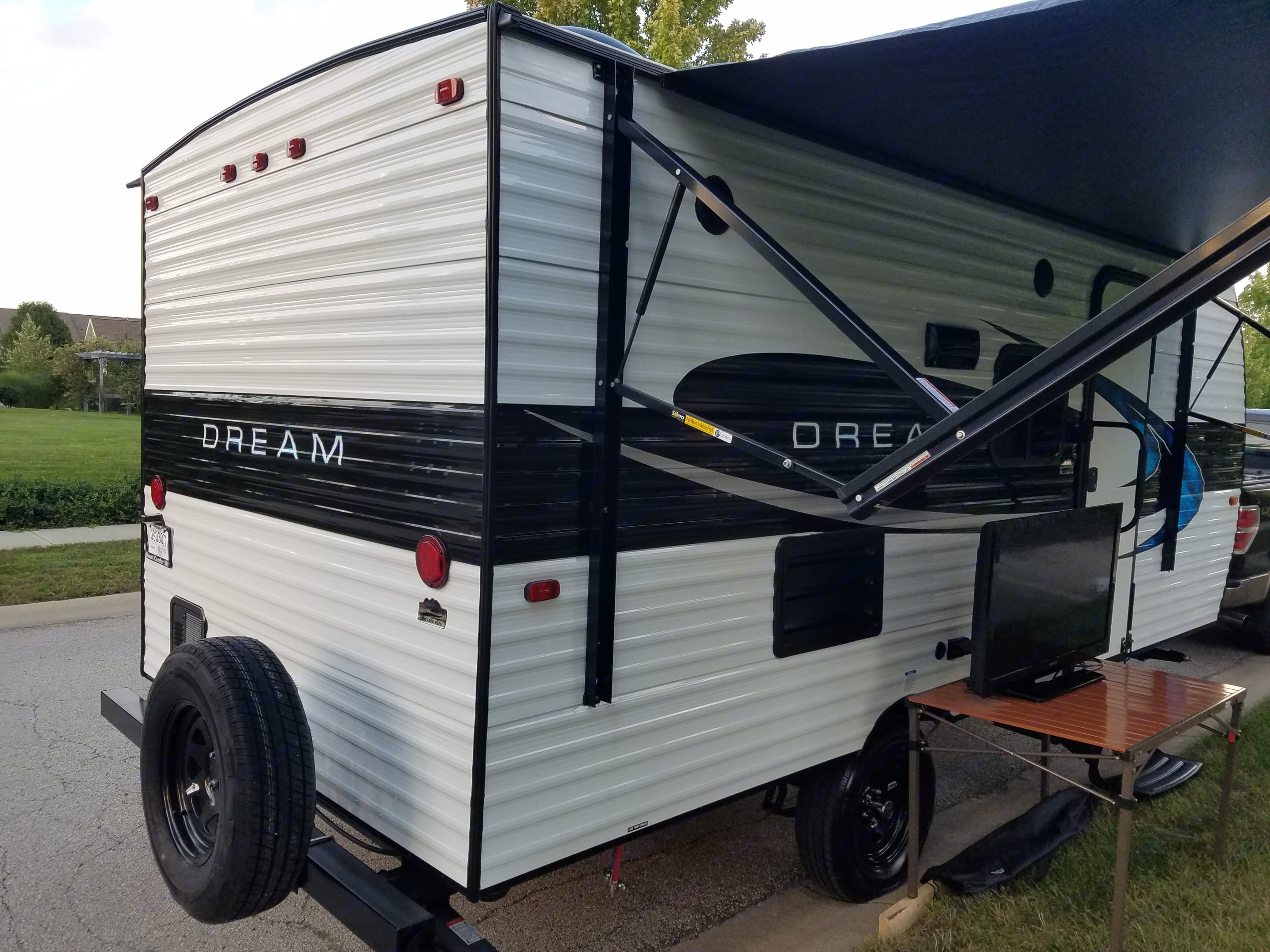 Rear view with outdoor TV set up. Outdoor shower on the back next to spare tire. Riverside Rv Other 2019