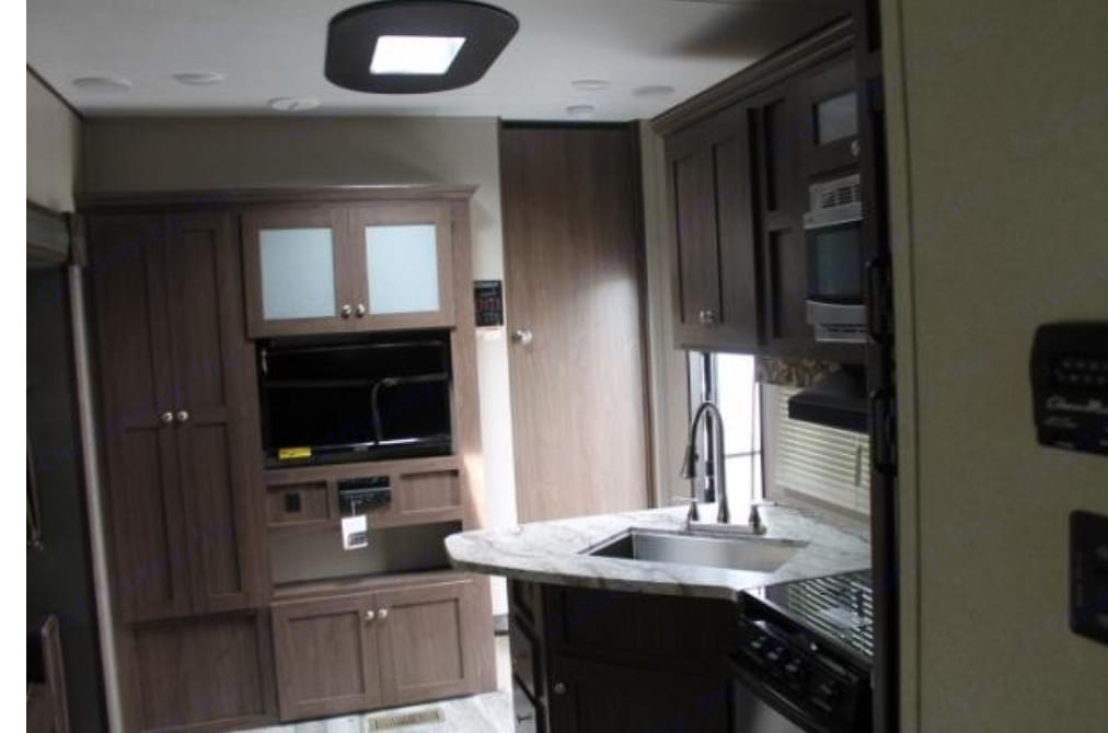 Pull out spicket with large counter space. Behind is door leading to master bedroom . Keystone Hideout 2018