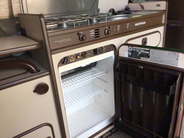 Clean fridge for your perishables. The fridge runs on propane, so we typically add ice packs to tide things over until we're parked and can switch it on.. Volkswagen Westfalia 1982