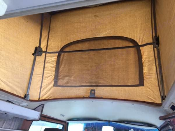 The glorious pop-top bunk with a front screen to let the breeze in at night.. Volkswagen Westfalia 1982