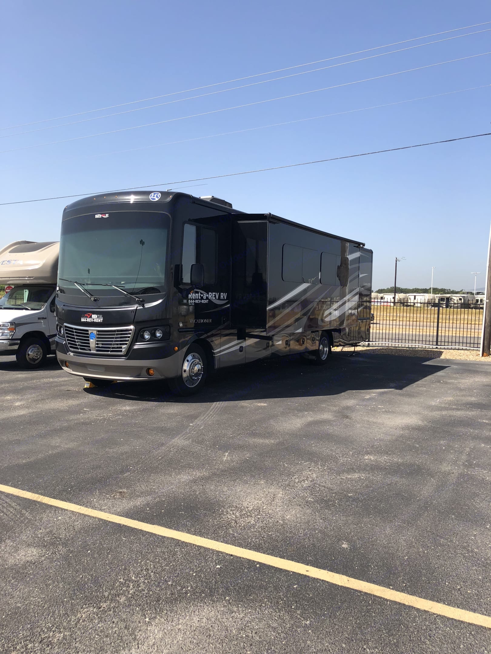 This 2017 Vacationer features a slide on each wall.  This unit comes with two rooftop A/C units to keep you cool in the summer heat and an electric or propane furnace to keep you warm in the winter.  . Holiday Rambler Vacationer 35K 2017