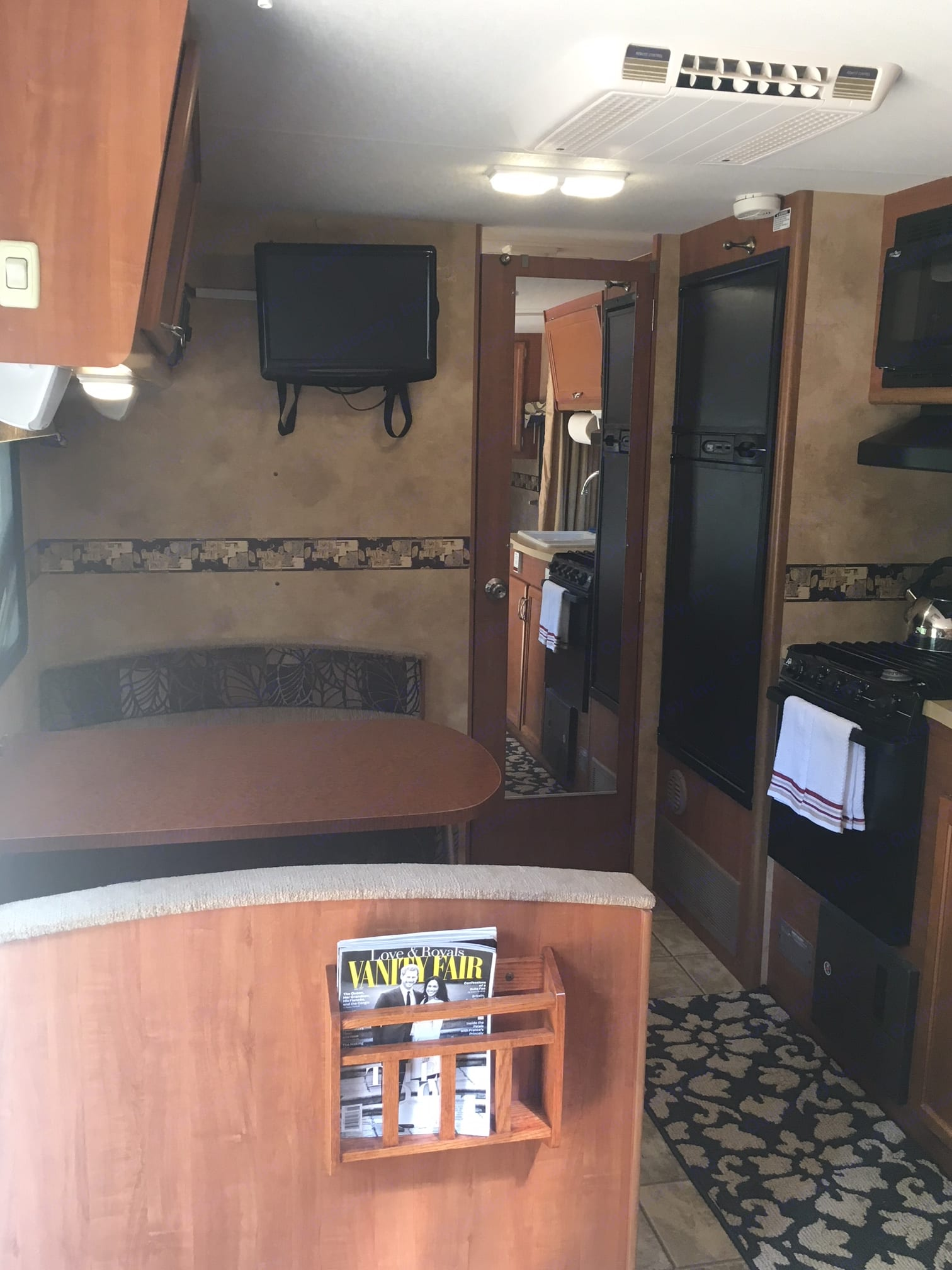 Flat screen TV can be viewed from the dinette and bed.. Lance 1881 2010