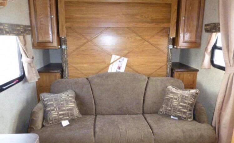 Sofa and queen size murphy bed with storage on both sizes. Forest River Rockwood Mini Lite 2015