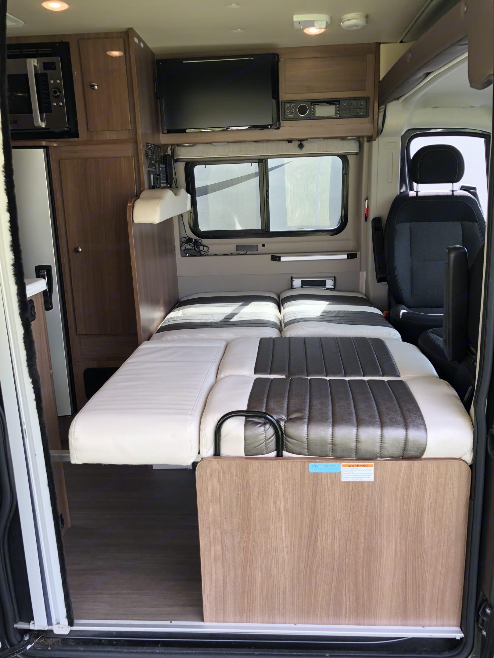 Forward sleeping area, dinette fold down.. Winnebago Travato 2017