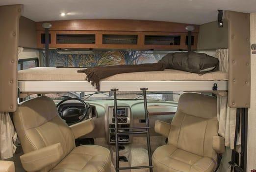 Electronic drop down loft bed above front seats. Winnebago Vista 2016