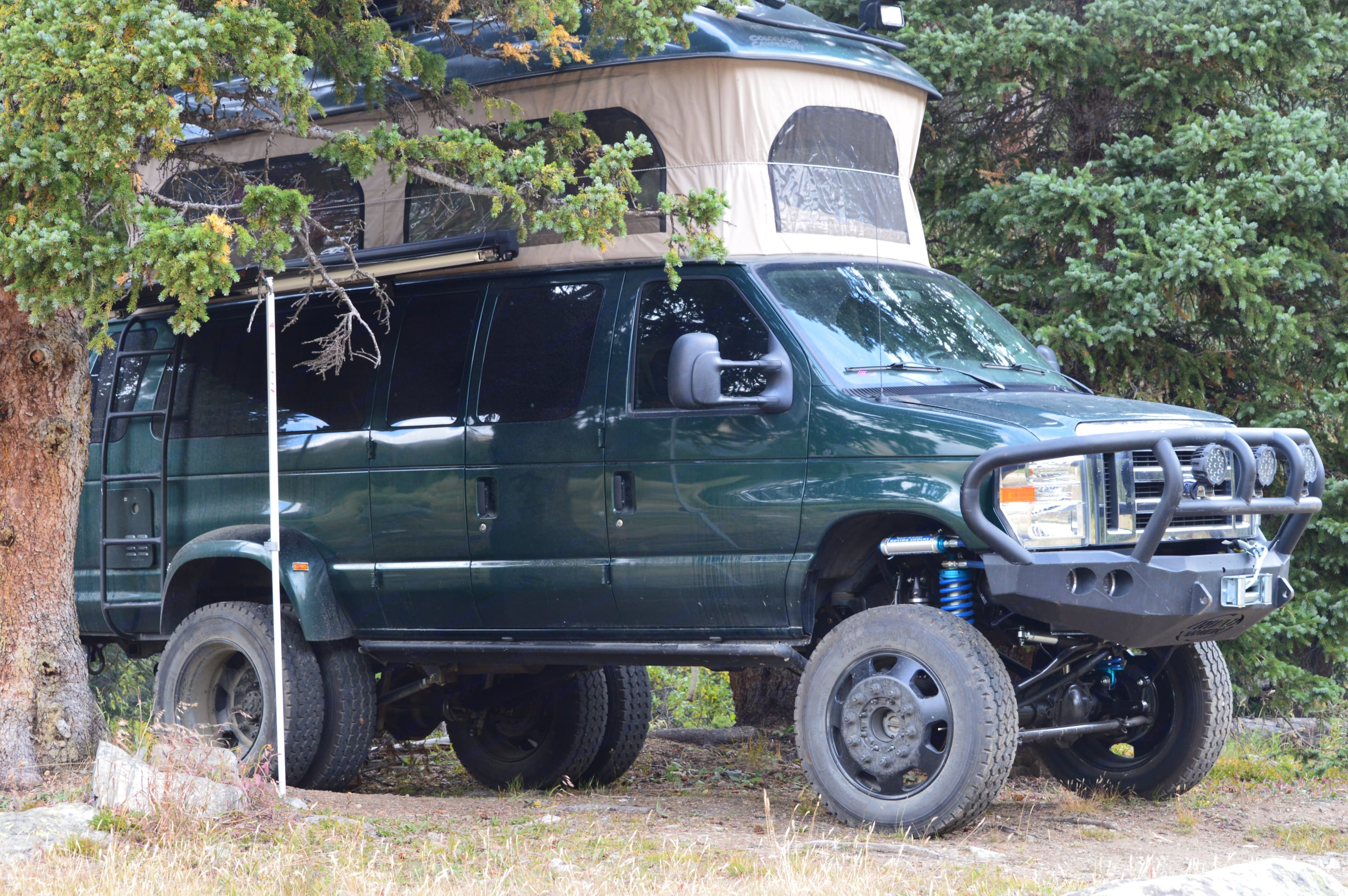 Always finding just the perfect spot.. Ford E350 Custom Off-road Conversion 2010