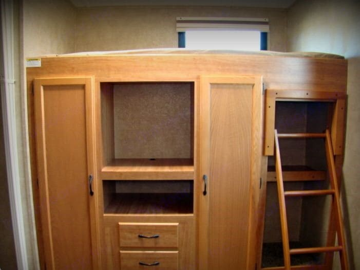 Entertainment centre in the kids bedroom.  Note the 2 closets in it for additional clothing storage!. Keystone Sprinter 2010