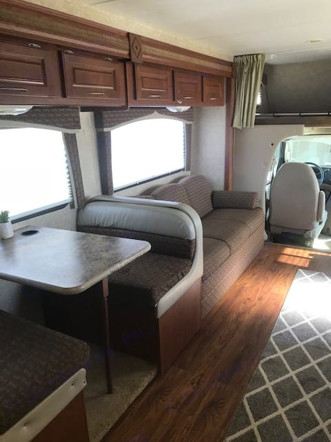 Both the dining table and the sofa convert to beds so your family has plenty of room to rest!. Thor Motor Coach Chateau 2010