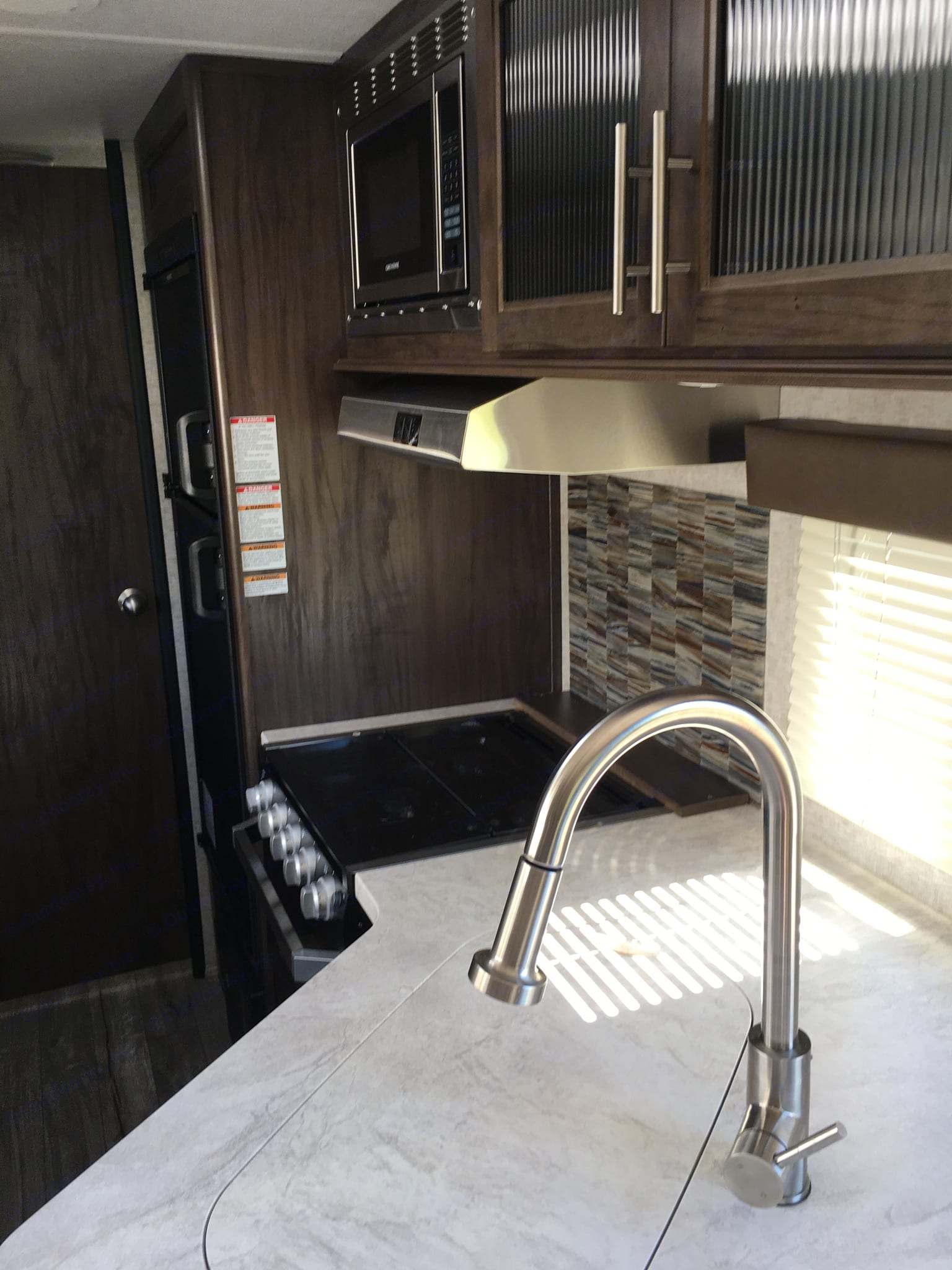 Kitchen sink, stove/range, fridge and freezer.. Forest River Cherokee Grey Wolf 2018