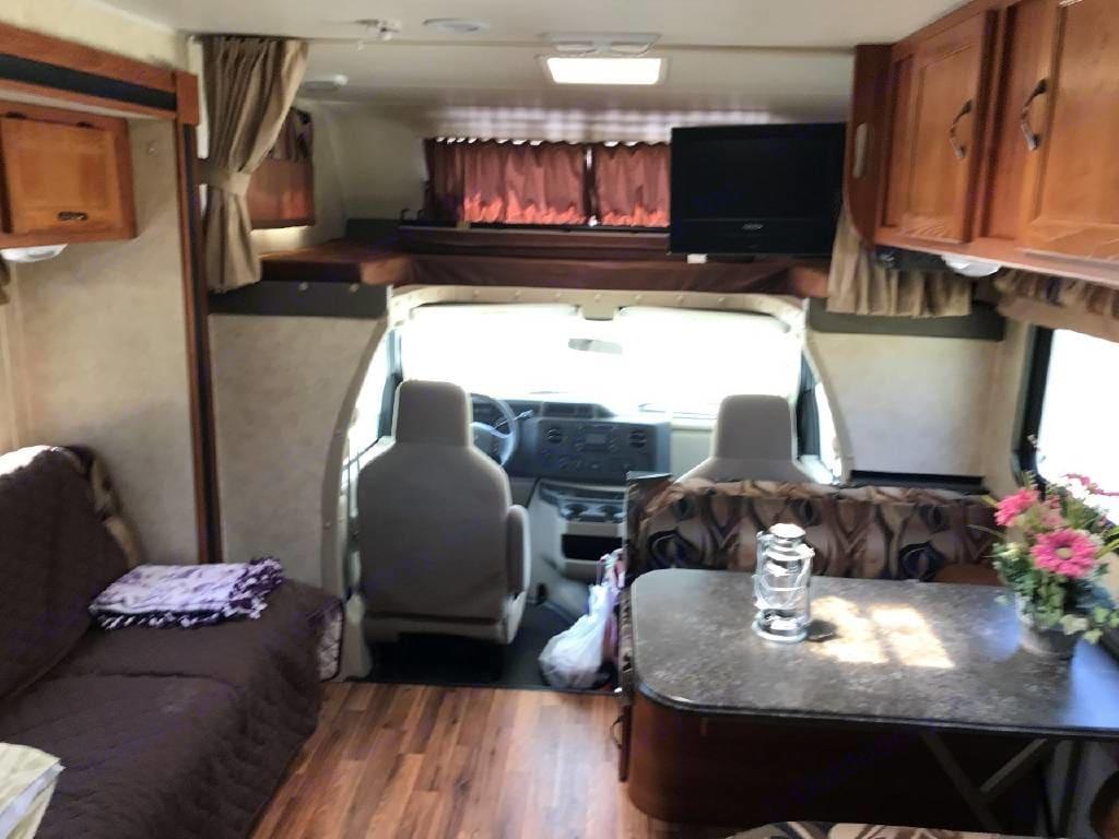 Dining, living, cab and over cab bunk. Coachmen Freelander 2012