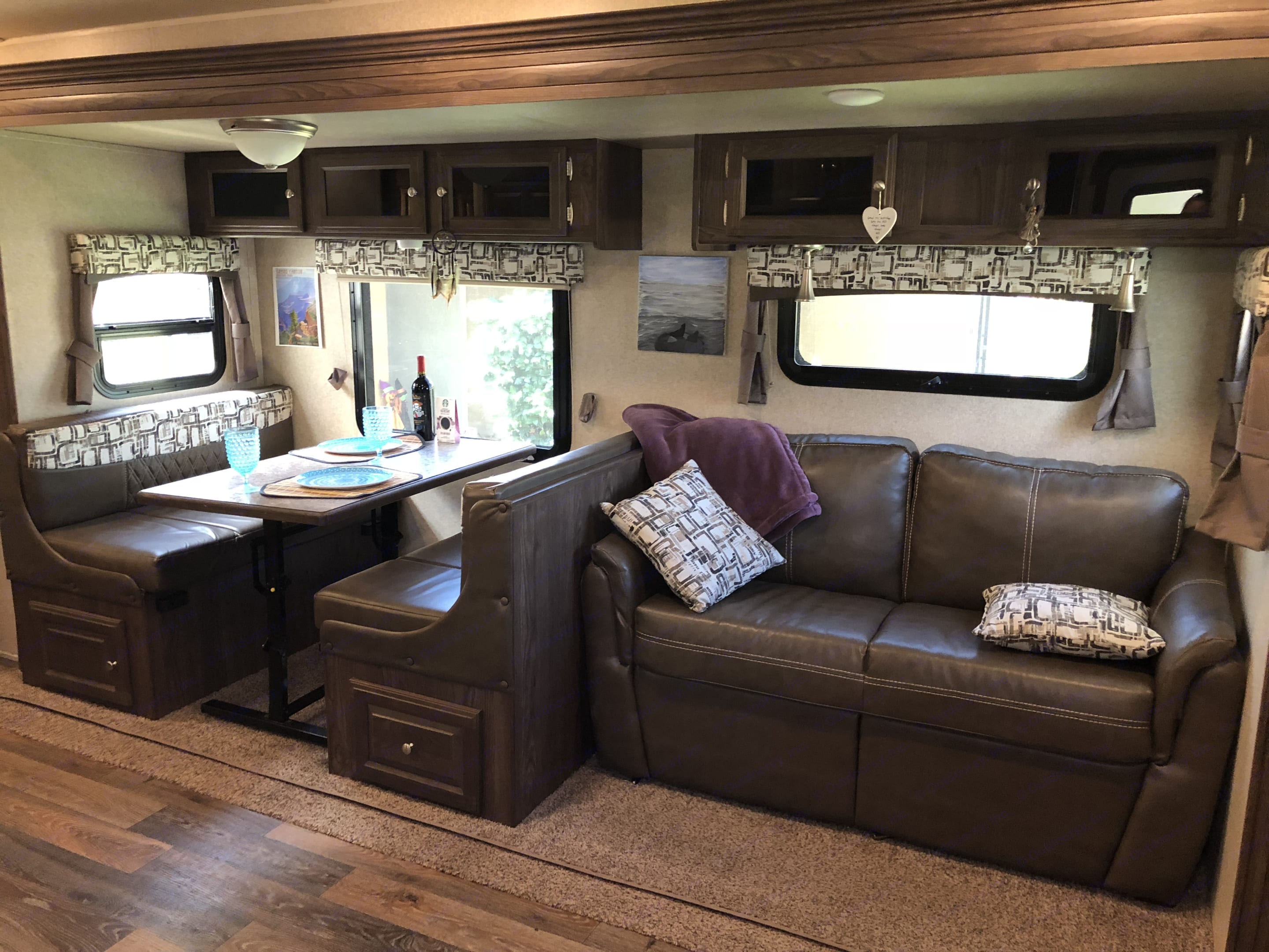 Table folds into a double bed. It seats 4 people comfortably. Forest River Rockwood Roo 2017