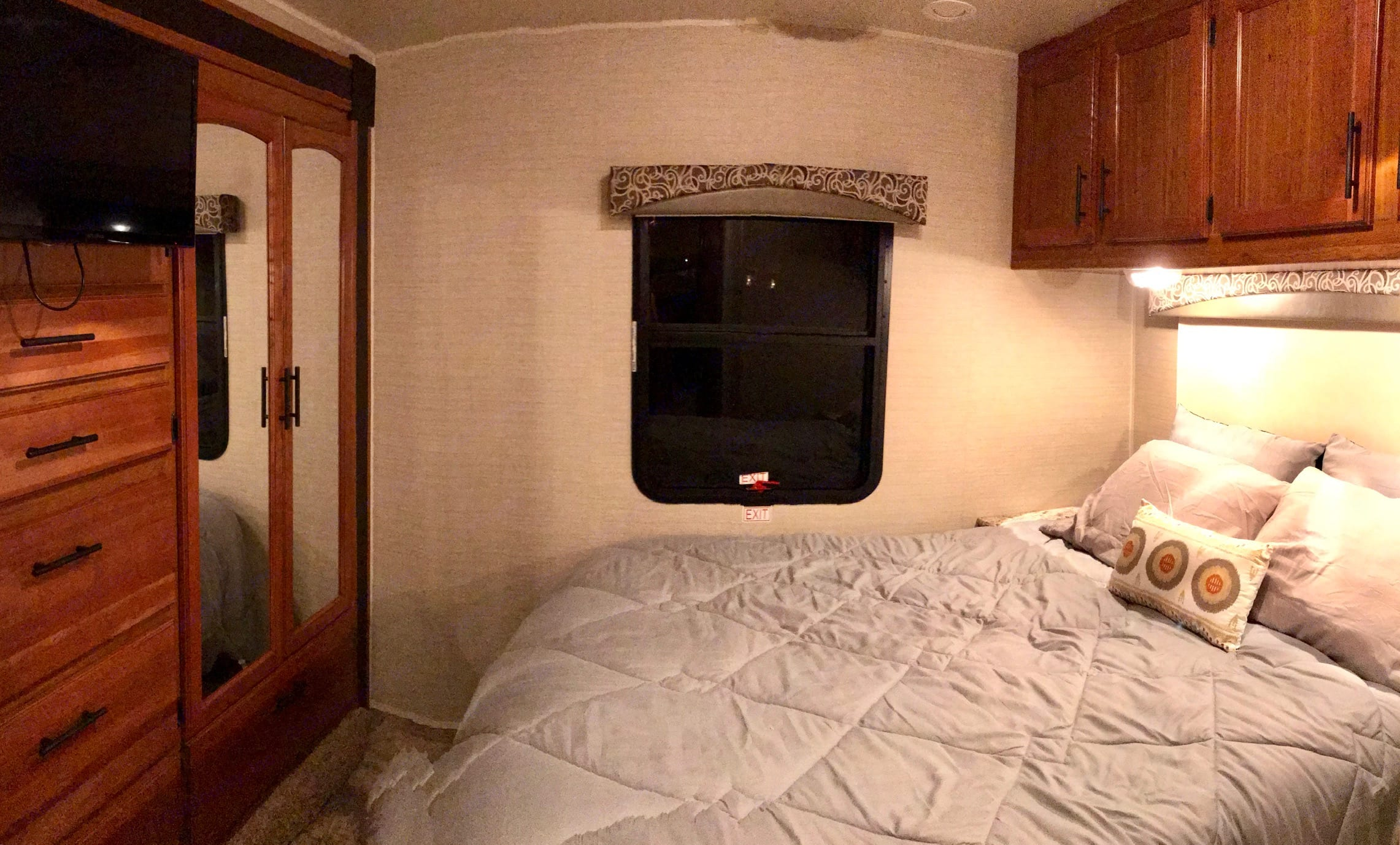 Master bedroom with queen size bed and lots of closet and storage space. Jayco Redhawk 2017