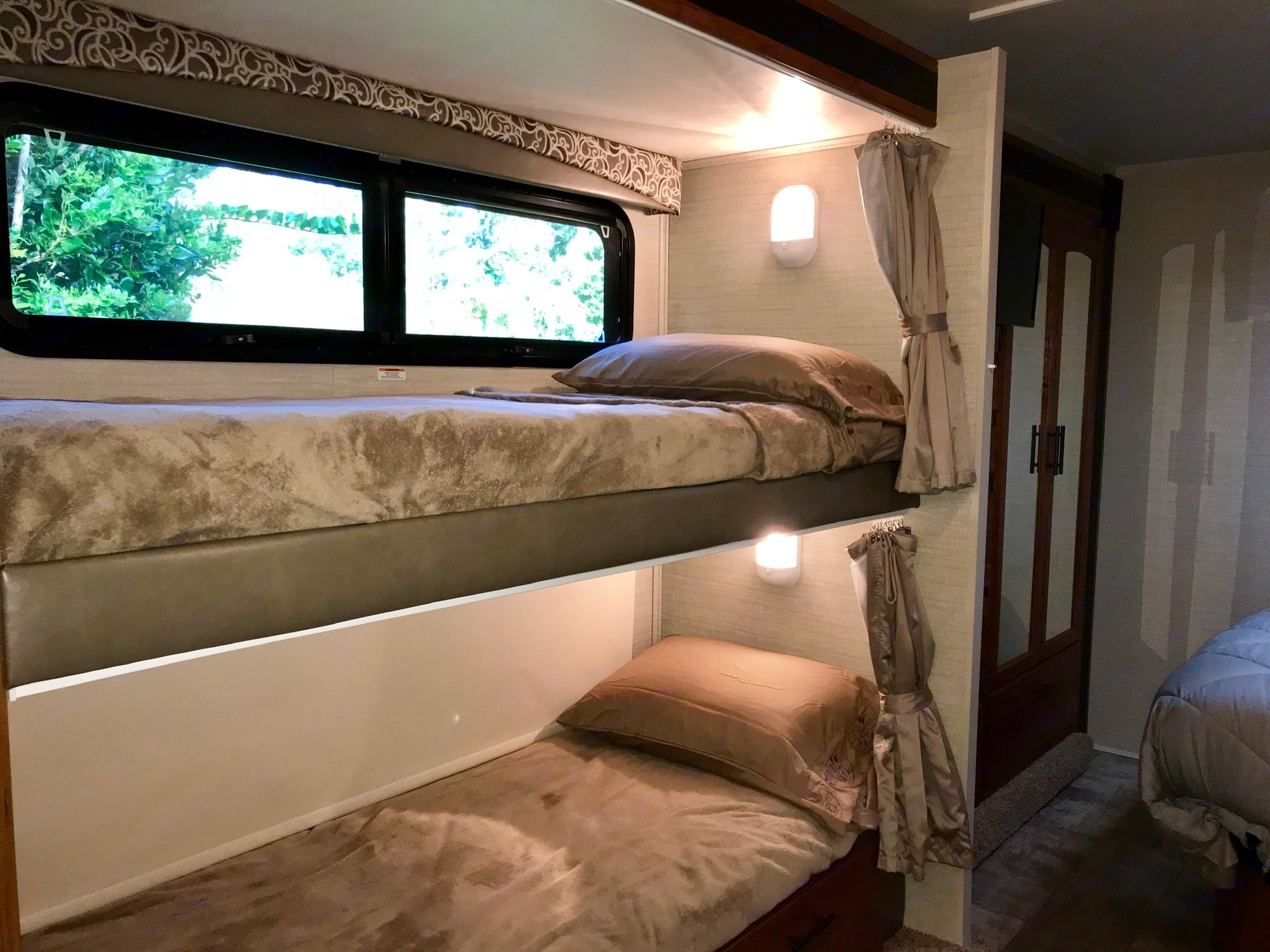 Large bunk beds, each with their own window, window shades and privacy curtains. Jayco Redhawk 2017
