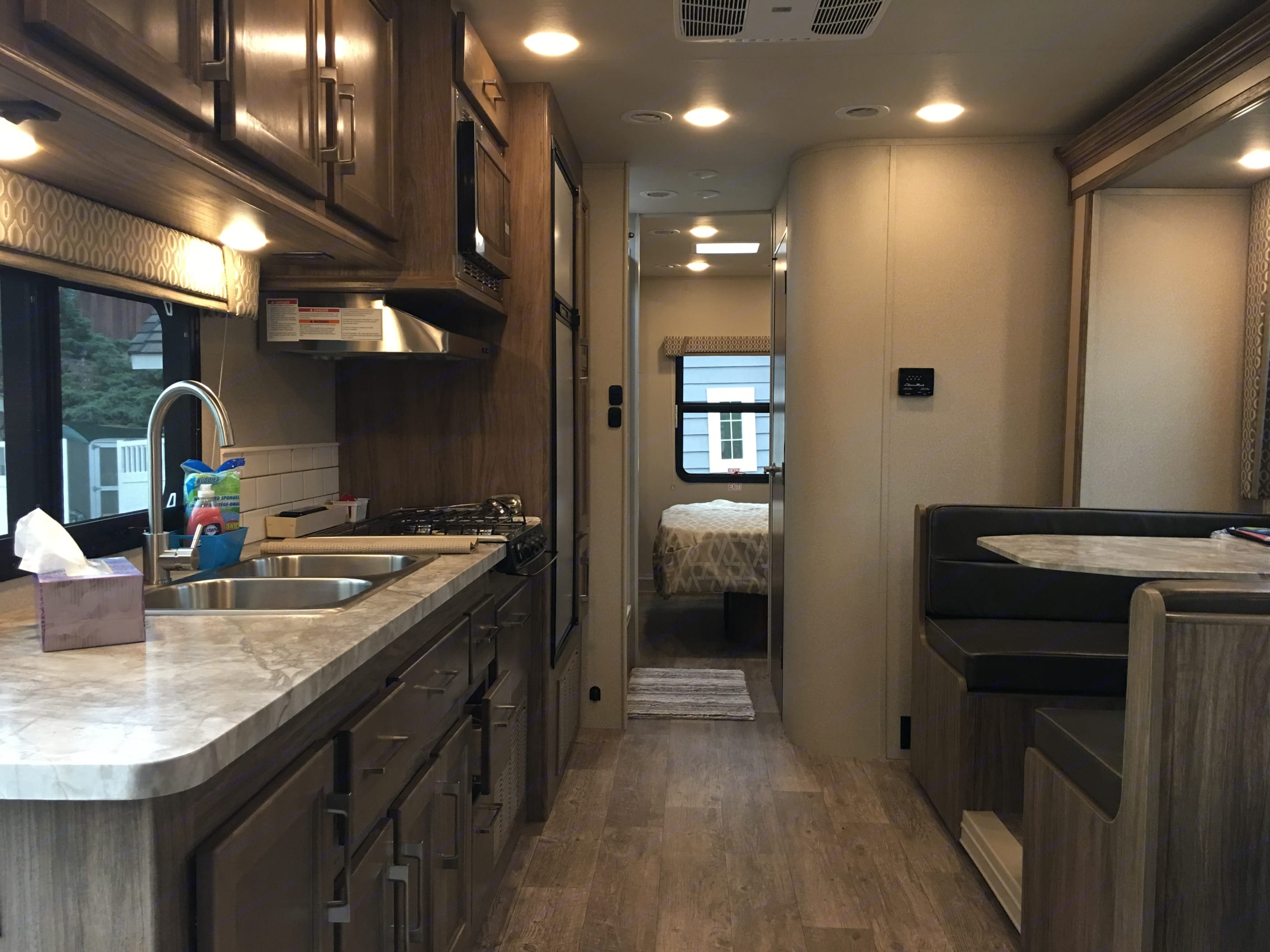 Looking aft. Slide out kitchen & dining area and master bedroom. Cozy. . Jayco Entegra 2018