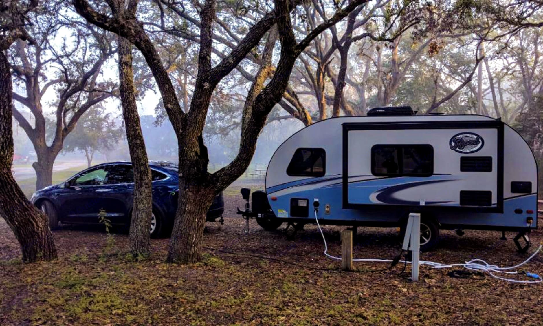 Yup, that's a Tesla! (in central Florida) -Actual travel trailer setup!. Forest River R-Pod 2018