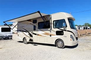 Outside with awning.  Includes an outdoor fridge, sink and propane gas line hookup at the back of the RV on the passenger side.. Thor Motor Coach A.C.E 2018