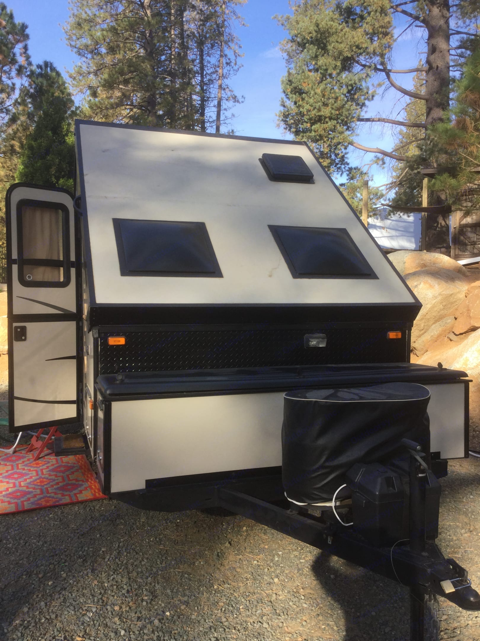 Front view- lots of storage, 2 propane tanks, one battery . Starcraft Comet 2014