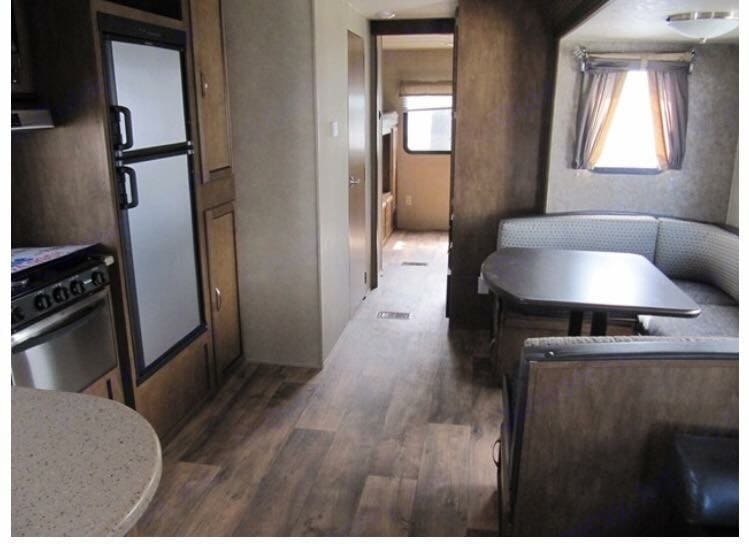 Hallway to bathroom and bunk house in back. Forest River T32BHDS 2016