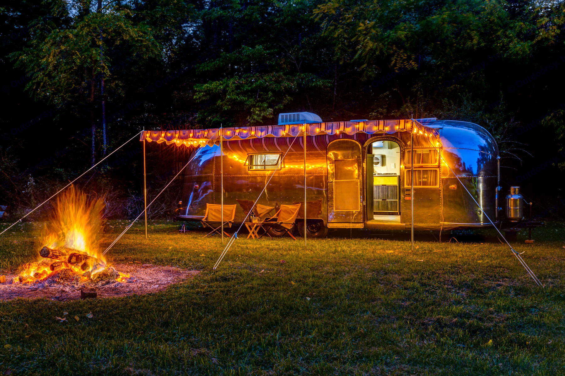This beautiful Airstream is sure to inspire as the evening sets in.. Airstream Overlander 1958