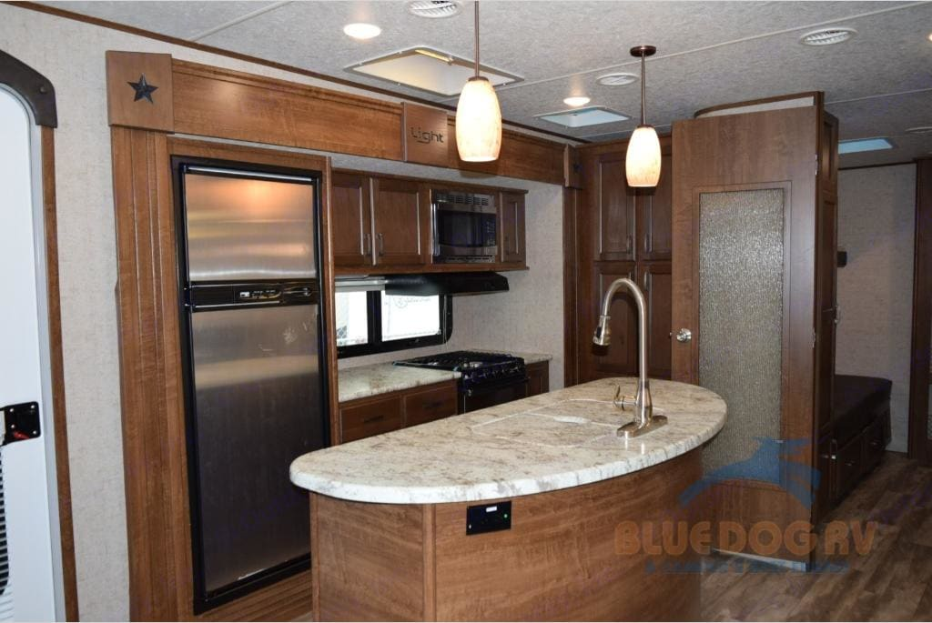 Spacious kitchen with large counter / island. Open Range Light 2018
