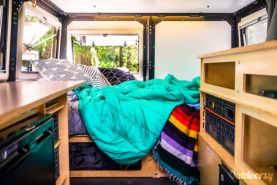 Full size bed converts to couch in the daytime.. TAXA Outdoors Mantis Trek 2018