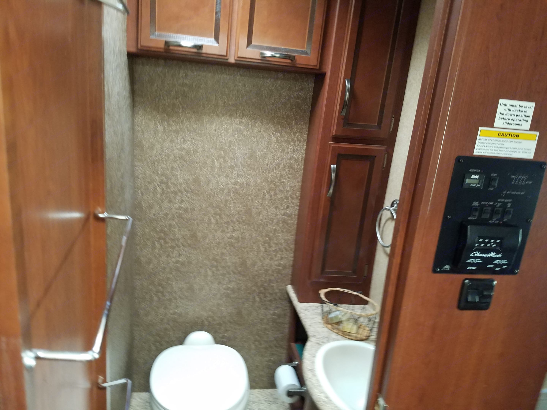 Bathroom with tons of storage.. Thor Motor Coach A.C.E 2014