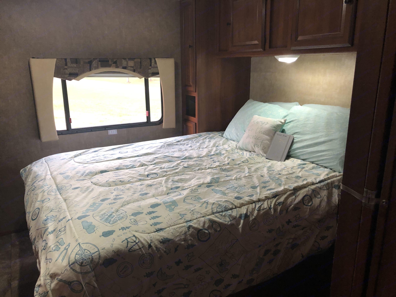 Master bedroom with Queen bed and privacy door. . Coachmen Leprechaun 2014