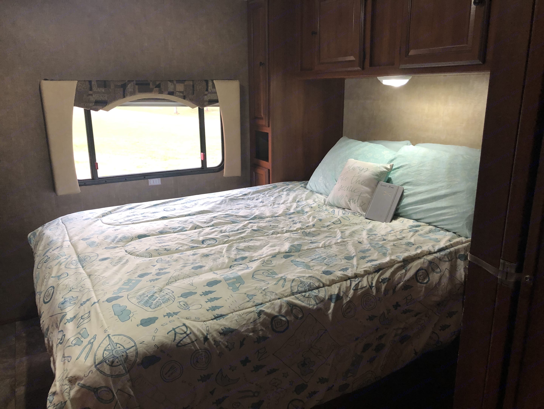Master bedroom with Queen bed and privacy door.. Coachmen Leprechaun 2014