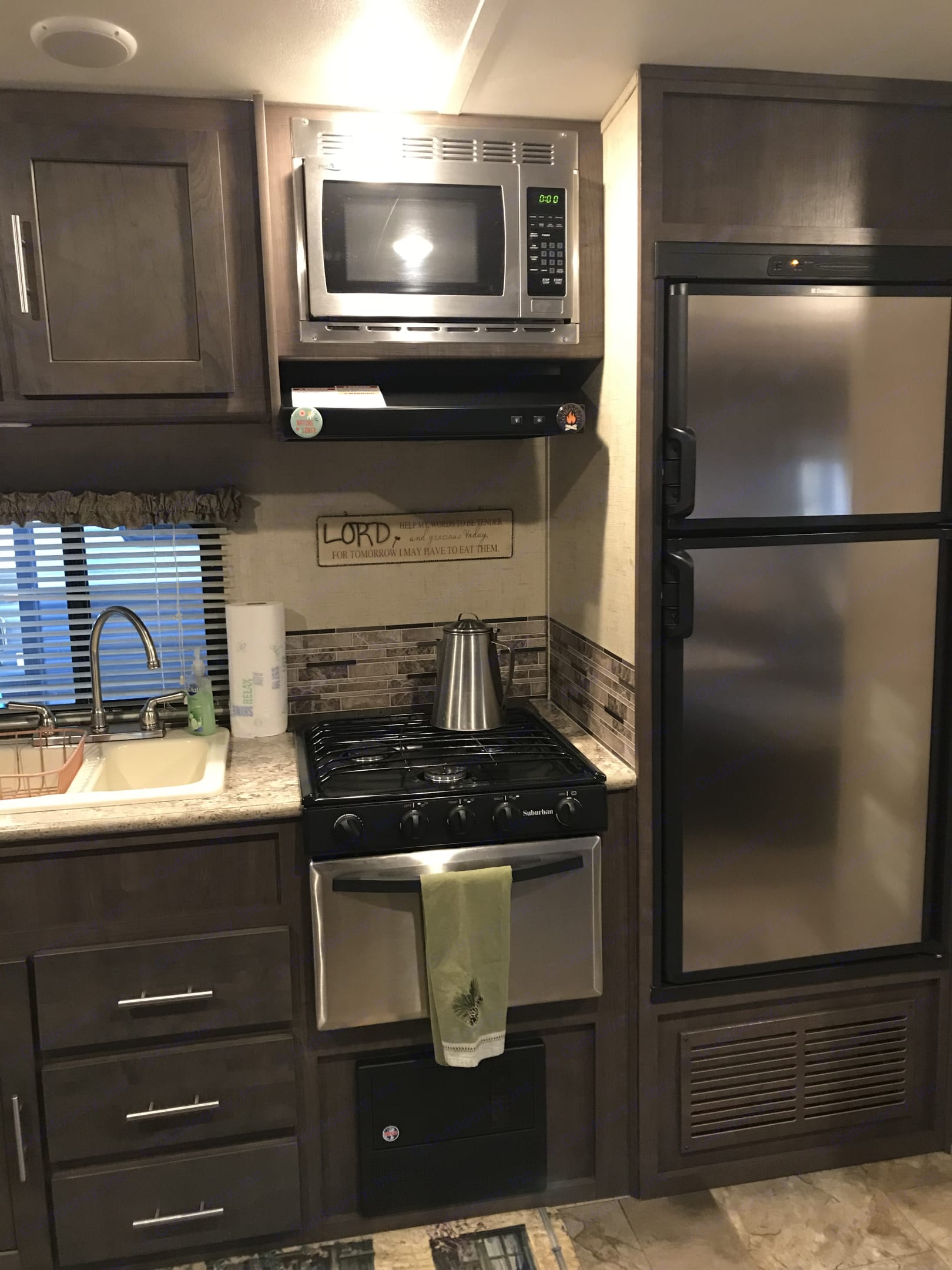 Kitchen area including a gas stove/oven, electric microwave, gas or electric refrigerator and a Keurig for easy, early morning coffee.. Forest River Surveyor 2016