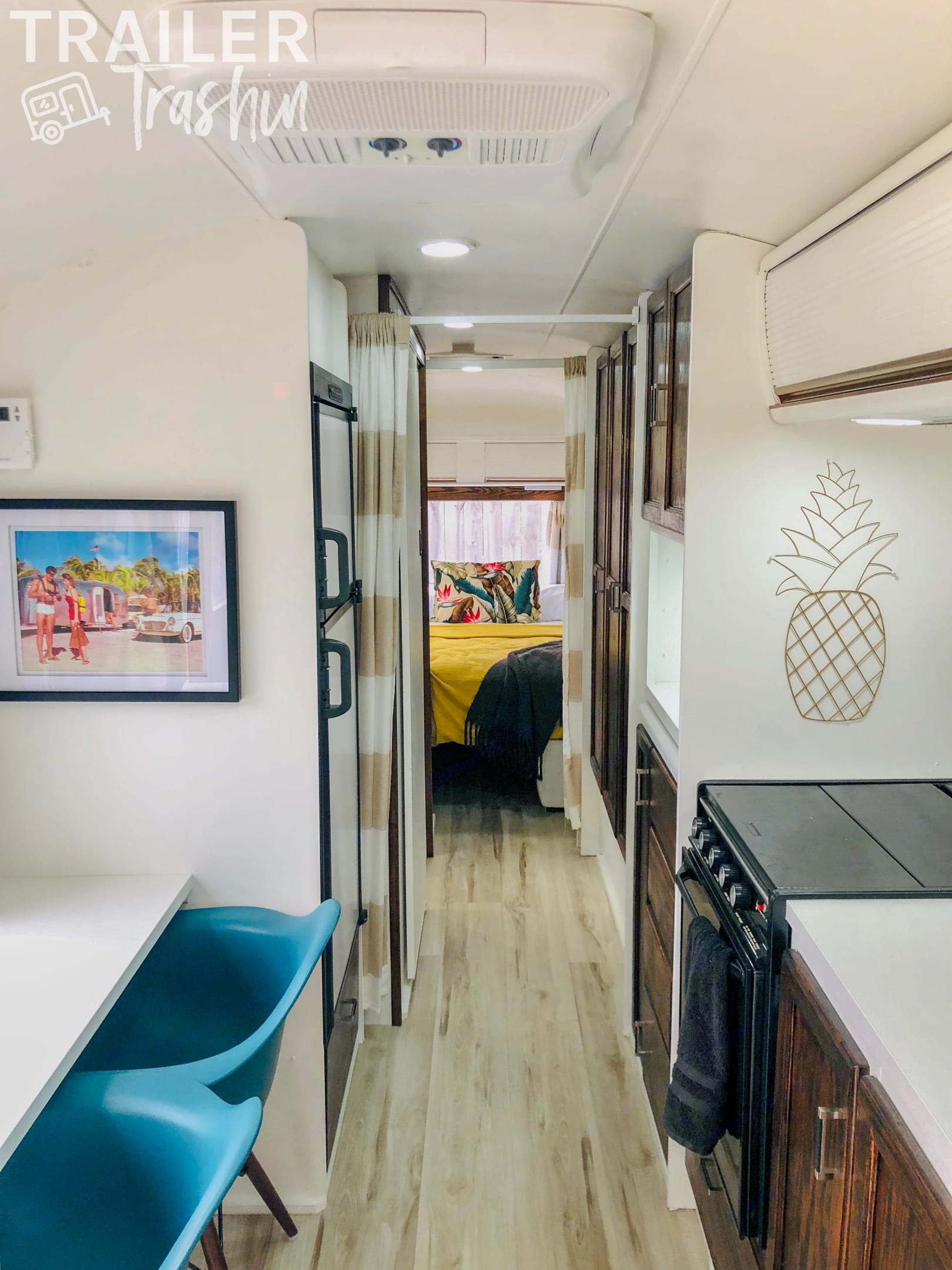 Master suite with ample storage, closets, and king size bed. There are partitions to offer some privacy in the small space. . Airstream Sovereign 1985