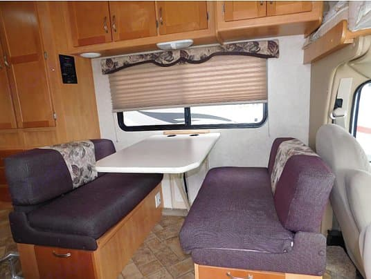 Dinette with large window Easily concert to a bed to sleep. Forest River Sunseeker 2009
