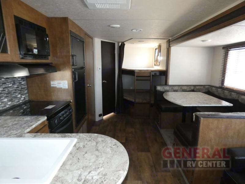 Interior view looking form the kitchen to the bunk area.. Forest River Wildwood X-Lite 2018