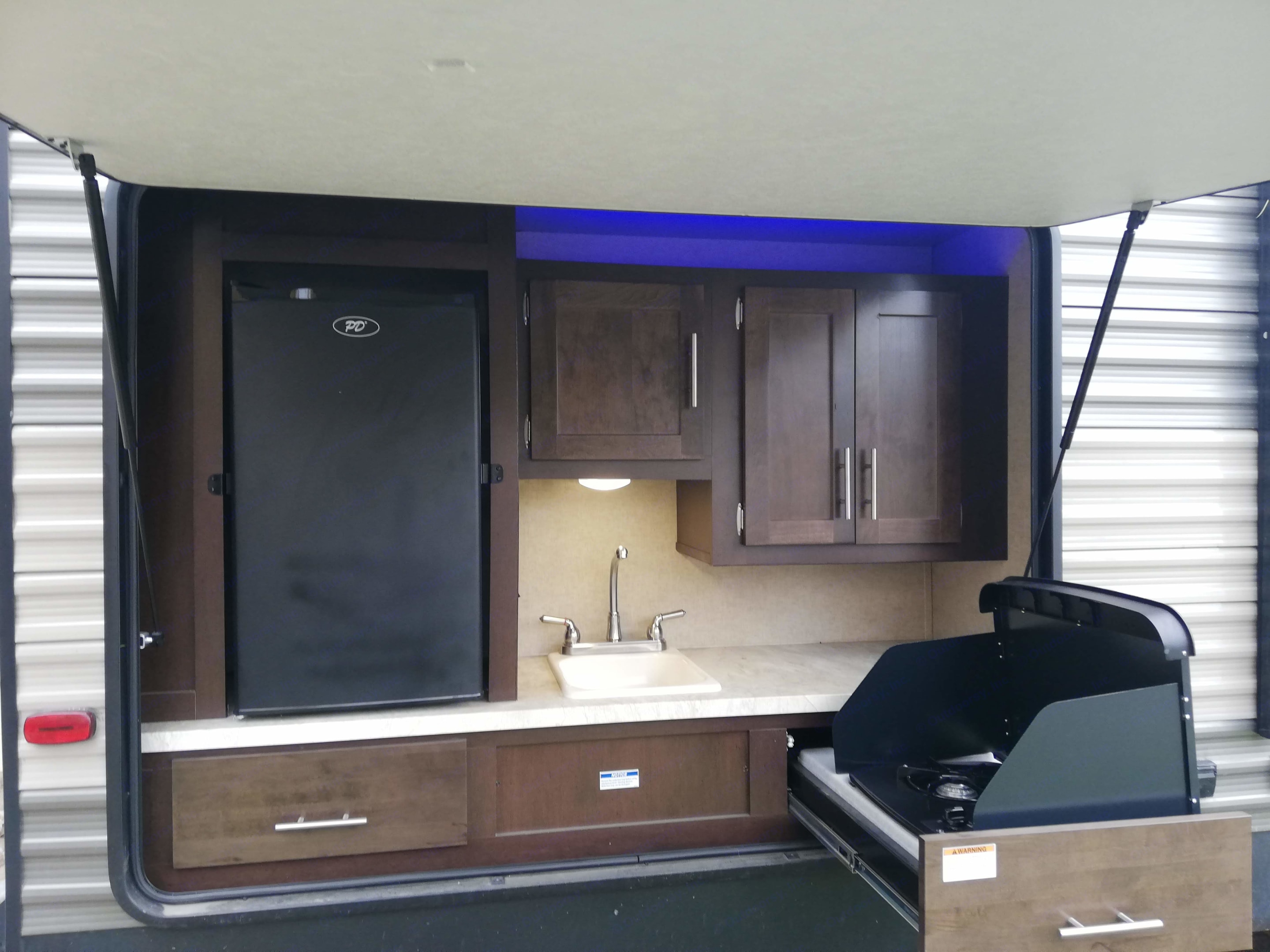 Outdoor kitchen with fridge, two burner propane stove, sink and storage!. Forest River Cherokee 2017