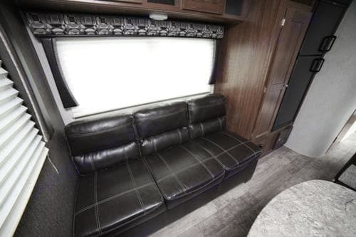 The couch can also fold down into a small bed.. Heartland Pioneer 2018